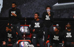 Sacramento Kings players cheer from the bench while wearing Black Lives Matters shirts in the first half of an NBA basketball game against the San Antonio Spurs, Friday, July 31, 2020, in Lake Buena Vista, Fla. (Kim Klement/Pool Photo via AP)