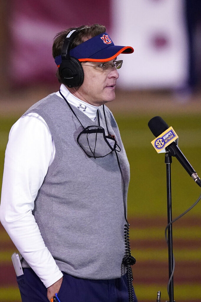 Then Auburn head coach Gus Malzahn responds to an SEC Network interview following an NCAA college football game against Mississippi State, Saturday, Dec. 12, 2020, in Starkville, Miss. Auburn athletic director Allen Greene announced the coach's firing on Sunday, Dec. 13, 2020,  a day after the Tigers finished the regular season with a 24-10 victory over Mississippi State. (AP Photo/Rogelio V. Solis)