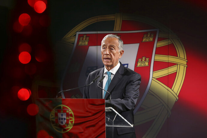 Portuguese President Marcelo Rebelo de Sousa announces that he will be running for reelection in the Jan. 24 presidential election, in Lisbon, Portugal, Monday, Dec. 7, 2020. Portugal holds a presidential election on Sunday, Jan. 24, 2021 and the moderate incumbent candidate is widely seen as the sure winner. But an intriguing question for many Portuguese is how well a brash new populist challenger fares in the ballot. Mainstream populism is a novelty in Portugal. (Manuel de Almeida/Pool via AP)
