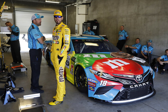 Monster Energy NASCAR Cup Series driver Kyle Busch waits in the garage before practice for the NASCAR Brickyard 400 auto race at the Indianapolis Motor Speedway, Saturday, Sept. 7, 2019 in Indianapolis. (AP Photo/Darron Cummings)