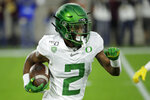 Oregon's Mykael Wright (2) carries on a kick return during the first half of the team's NCAA college football game against the Arizona State, Saturday, Nov. 23, 2019, in Tempe, Ariz. (AP Photo/Matt York)