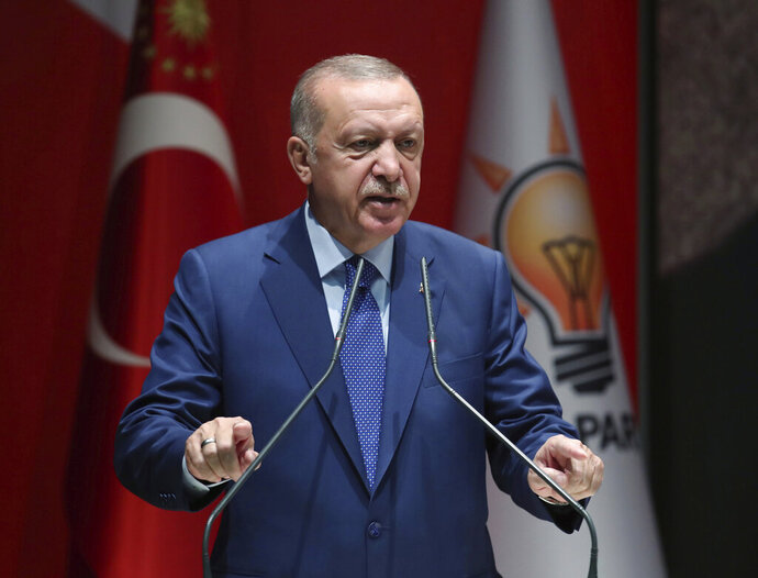 Turkey's President Recep Tayyip Erdogan speaks to his ruling party officials, in Ankara, Turkey, Thursday, Sept. 5, 2019. Erdogan has threatened to allow Syrian refugees in Turkey to travel toward the West unless a so-called safe zone in Syria is established. Erdogan also said Turkey was determined to create a safe zone and would act alone if no agreement is reached on the issue with the United States by the end of the month. (Presidential Press Service via AP, Pool)
