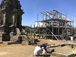 In this July 31, 2019, photo, tourists take photos of temples which is currently under renovation at Arjuna Temple in Dieng, Central Java, Indonesia. The Indonesian city of Yogyakarta and its hinterland are packed with tourist attractions, including Buddhist and Hindu temples of World Heritage. Yet many tourists still bypass the congested city and head to the relaxing beaches of Bali. Recently re-elected President Joko Widodo wants to change this dynamic by pushing ahead with creating