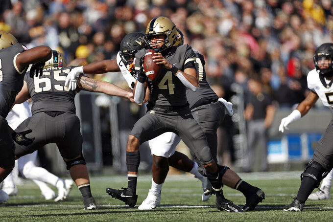 Army quarterback Christian Anderson (4) looks to pass under pressure against Wake Forest during the first half of an NCAA college football game Saturday, Oct. 23, 2021, in West Point, N.Y. (AP Photo/Adam Hunger)