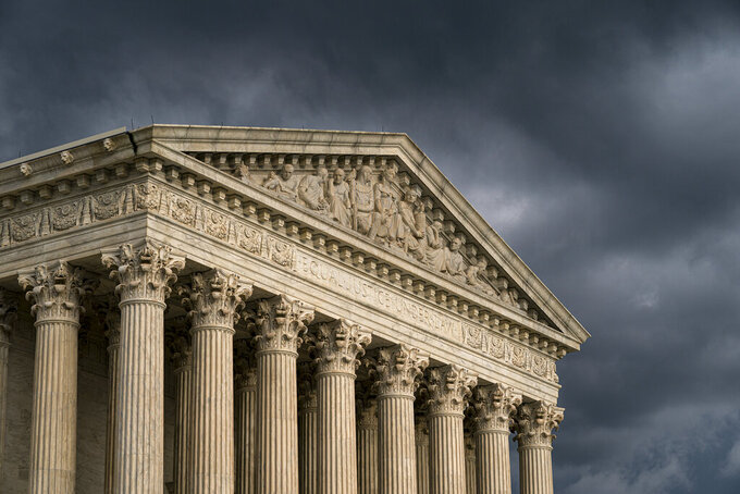 FILE - In this June 20, 2019, file photo, the Supreme Court is seen in Washington as a storm rolls in. The Supreme Court seems inclined to say that hundreds of millions of dollars in coronavirus relief money tied up by a court case should benefit Alaska Natives, rather than be spread more broadly among Native American tribes.The justices were hearing arguments April 19, 2021, in a case involving the massive pandemic relief package passed last year and signed into law by then-President Donald Trump.  (AP Photo/J. Scott Applewhite, File)