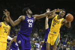TCU center Kevin Samuel, left, blocks the shot of Baylor guard Jared Butler, right, in the second half of an NCAA college basketball game, Saturday, Feb. 1, 2020, in Waco, Texas. Baylor won 68-52. (AP Photo/Rod Aydelotte)