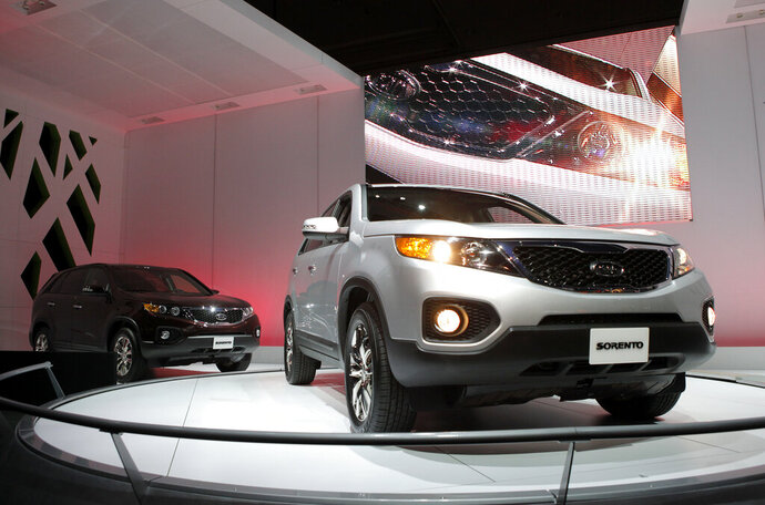 FILE - In this Dec. 2, 2009, file photo, the 2011 Kia Sorento debuts at the Los Angeles Auto Show in Los Angeles. Kia is joining its affiliate Hyundai in recalling thousands of vehicles in the U.S. because water can get into a brake computer, cause an electrical short and possibly a fire. The Kia recall covers nearly 229,000 Sedona minivans from the 2006 through 2010 model years. Also covered are Sorento SUVs from 2007 through 2009. (AP Photo/Jae C. Hong, File)