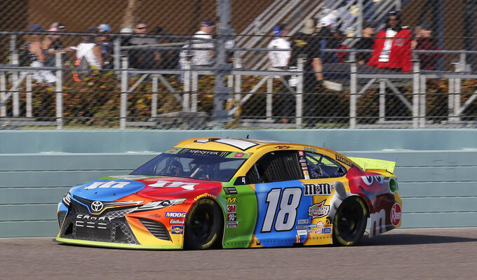 Kyle Busch drives on the front stretch during a NASCAR Cup Series auto race on Sunday, Nov. 17, 2019, at Homestead-Miami Speedway in Homestead, Fla. Busch is one of four drivers running for the championship. (AP Photo/Terry Renna)