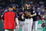 Cleveland Indians manager Terry Francona, left, heads out to take the ball from starting pitcher Mike Clevinger, right front, who stands on the mound surrounded by the infield in the fifth inning of a baseball game against the Texas Rangers in Arlington, Texas, Monday, June 17, 2019. (AP Photo/Tony Gutierrez)