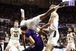 Purdue forward Aaron Wheeler (1) falls on to Northwestern forward A.J. Turner (21) during the first half of an NCAA college basketball game in West Lafayette, Ind., Sunday, Dec. 8, 2019. (AP Photo/Michael Conroy)