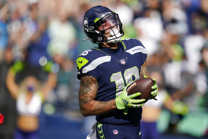 Seattle Seahawks wide receiver Freddie Swain holds the ball after he scored a touchdown against the Tennessee Titans during the second half of an NFL football game, Sunday, Sept. 19, 2021, in Seattle. (AP Photo/Elaine Thompson)