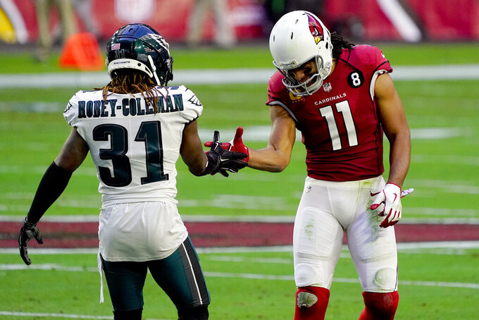 Arizona Cardinals wide receiver Larry Fitzgerald (11) laughs as he greets Philadelphia Eagles cornerback Nickell Robey-Coleman (31) during the first half of an NFL football game, Sunday, Dec. 20, 2020, in Glendale, Ariz. (AP Photo/Rick Scuteri)