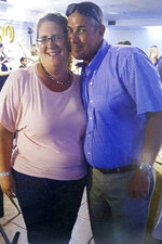 """This undated image provided by Jason Nixon, shows a photo of Jason and his wife Kate Nixon, prior to last years shooting that took the life of Kate Nixon in Virginia Beach, Va. As the shooting's one-year anniversary approaches, some of the victim's family members say the rampage is effectively forgotten. """"We were a flash in the pan,"""" Nixon said. """"I think that we should have had a lot more attention. It's not normal for someone to wake up and go murder 12 people."""" (Jason Nixon via AP)"""