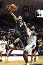 Green Bay guard Kameron Hankerson (21) shoots over Purdue forward Trevion Williams (50) during the first half of an NCAA college basketball game in West Lafayette, Ind., Wednesday, Nov. 6, 2019. (AP Photo/Michael Conroy)