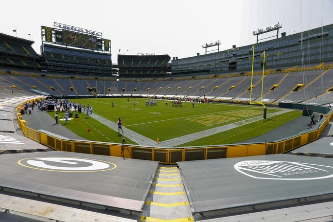 The stands at Lambeau Field are empty during the second half of an NFL football game Sunday, between the Green Bay Packers and the Detroit Lions Sept. 20, 2020, in Green Bay, Wis. (AP Photo/Mike Roemer)