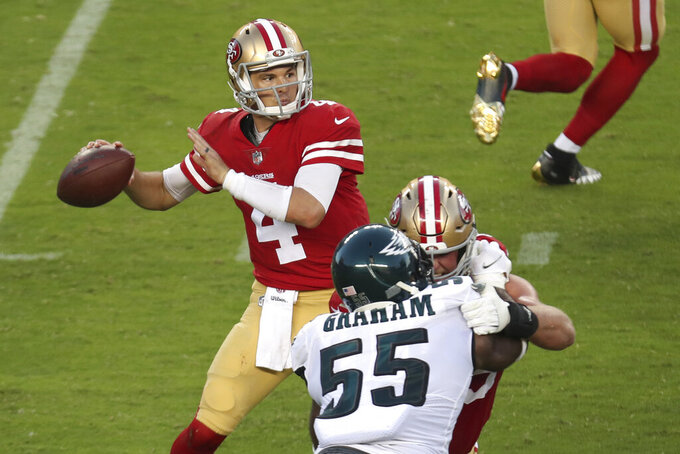 San Francisco 49ers quarterback Nick Mullens (4) passes against the Philadelphia Eagles during the first half of an NFL football game in Santa Clara, Calif., Sunday, Oct. 4, 2020. (AP Photo/Jed Jacobsohn)