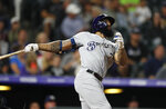 FILE - In this Sept. 28, 2019, file photo, Milwaukee Brewers' Eric Thames connects for a solo home run off Colorado Rockies starting pitcher Chi Chi Gonzalez in the fifth inning of a baseball game in Denver. The Brewers cut $15 million in payroll for next season, trading right-hander Chase Anderson to the Toronto Blue Jays on Monday, Nov. 4, 2019, for prospect Chad Spanberger and declining a $7.5 million option on first baseman Thames.(AP Photo/David Zalubowski, File)