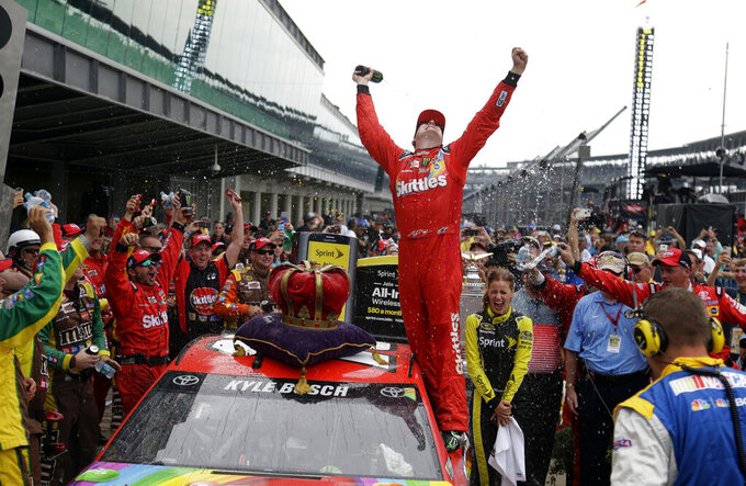 FILE - In this July 26, 2015, file photo, Kyle Busch celebrates after winning the NASCAR Brickyard 400 auto race at Indianapolis Motor Speedway in Indianapolis. NASCAR made the first significant changes to its schedule in years by shuffling the 2020 season into a freshened new sequence that tries to meet the wants of fans to the best of NASCAR's current ability. (AP Photo/Michael Conroy, File)
