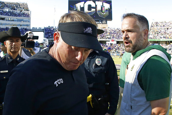 TCU head coach Gary Patterson and Baylor head coach Matt Rhule meet on the field following an NCAA college football game Saturday, Nov. 9, 2019, in Fort Worth, Texas. Baylor won 29-23 in triple overtime. (AP Photo/Ron Jenkins)