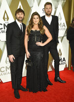 Dave Haywood, from left, Hillary Scott, and Charles Kelley of Lady Antebellum arrive at the 53rd annual CMA Awards at Bridgestone Arena on Wednesday, Nov. 13, 2019, in Nashville, Tenn. (Photo by Evan Agostini/Invision/AP)