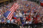 Fans celebrate after the United States scored a goal in the 2019 FIFA Women's World Cup soccer final between against the Netherlands Sunday, July 7, 2019, in Kansas City, Mo. The United States won 2-0. (AP Photo/Charlie Riedel)