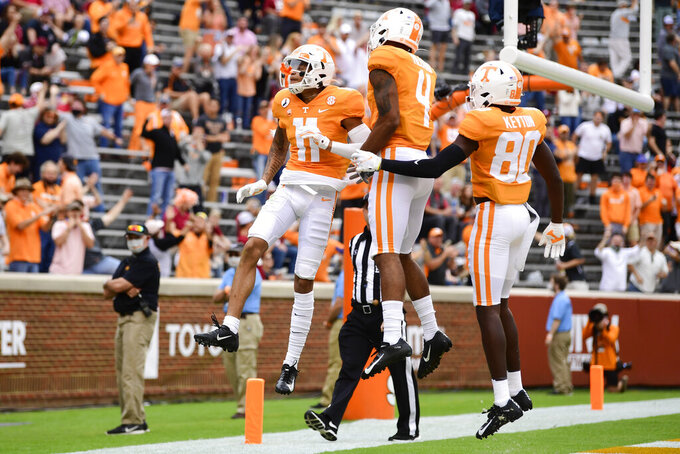 Tennessee wide receiver Jalin Hyatt (11) celebrates after scoring a touchdown against Alabama in the second half of an NCAA college football game in Knoxville, Tenn., Saturday, Oct. 24, 2020. (Caitie McMekin/Knoxville News Sentinel via AP)