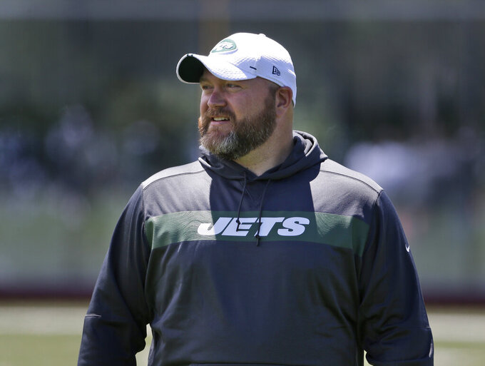 New York Jets general manager Joe Douglas greets reporters during a practice at the team's NFL football training facility in Florham Park, N.J., Tuesday, June 11, 2019. (AP Photo/Seth Wenig)