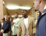 Former Wisconsin Badger football player Quintez Cephus, second from right, arrives at a press conference to reiterate his request for reinstatement to the university in Madison, Wis. Monday, Aug. 12, 2019. The former wide receiver was acquitted earlier this month of sexual assault charges stemming from a campus incident in his apartment. He was expelled from the university in March after the university's own internal investigation. A group of current team members were on hand to show support for Cephus at the event. (John Hart/Wisconsin State Journal via AP)