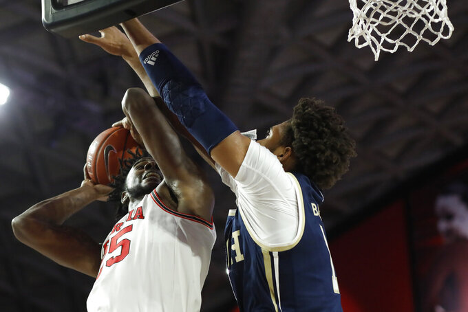 Georgia's Amanze Ngumezi, left, shoots while defended by Georgia Tech forward James Bnaks III during an NCAA college basketball game Wednesday, Nov. 20, 2019, in Athens, Ga. (Joshua L. Jones/Athens Banner-Herald via AP)