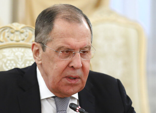 In this photo released by Russian Foreign Ministry Press Service, Russian Foreign Minister Sergei Lavrov attends a meeting with Armenia's Foreign Minister Zohrab Mnatsakanyan in Moscow, Russia, Monday, Oct. 12, 2020. (Russian Foreign Ministry Press Service via AP)