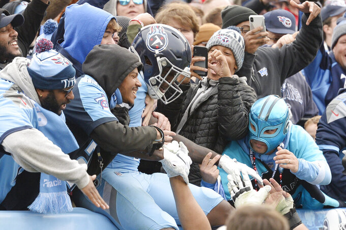 Tennessee Titans wide receiver A.J. Brown celebrates after scoring a touchdown against the Houston Texans in the second half of an NFL football game Sunday, Dec. 15, 2019, in Nashville, Tenn. (AP Photo/Mark Zaleski)