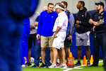 Florida head coach Dan Mullen, left, and New England Patriots head coach Bill Belichick talk during University of Florida's football Pro Day in Gainesville, Fla., Wednesday, March 27, 2019.  (Lauren Bacho/The Gainesville Sun via AP)