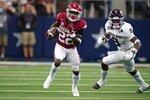Arkansas running back Trelon Smith (22) runs the ball as Texas A&M defensive back Leon O'Neal Jr. (9) gives chase in the first half of an NCAA college football game in Arlington, Texas, Saturday, Sept. 25, 2021. (AP Photo/Tony Gutierrez)
