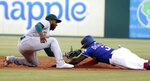 Oakland Athletics second base Jurickson Profar tags out Texas Rangers' Delino DeShields, who was attempting to steal second during the first inning of a baseball game in Arlington, Texas, Friday, June 7, 2019. (AP Photo/Tony Gutierrez)