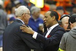 North Carolina State head coach Kevin Keatts, right, greets Syracuse head coach Jim Boeheim, left, before an NCAA college basketball game in Syracuse, N.Y., Tuesday, Feb. 11, 2020. (AP Photo/Nick Lisi)