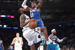New York Knicks guard Frank Ntilikina (11) fouls Denver Nuggets guard Will Barton during the first half of an NBA basketball game Thursday, Dec. 5, 2019, at Madison Square Garden in New York. (AP Photo/Mary Altaffer)