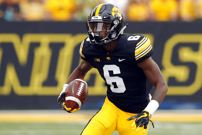 FILE - In this Sept. 1, 2018, file photo, Iowa wide receiver Ihmir Smith-Marsette runs up field after making a reception during the first half of an NCAA college football game against Northern Illinois in Iowa City, Iowa. The Hawkeyes have more potential on the outside than they've had in years, with proven juniors Ihmir Smith-Marsette and Brandon Smith expected to be bolstered by promising freshman Tyrone Tracy Jr. and Nico Ragaini. (AP Photo/Charlie Neibergall)