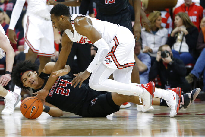 Rutgers' Ron Harper, left, and Ohio State's Andre Wesson fight for a loose ball during the first half of an NCAA college basketball game Wednesday, Feb. 12, 2020, in Columbus, Ohio. (AP Photo/Jay LaPrete)