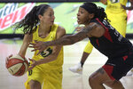 Seattle Storm guard Sue Bird (10) is defended by Las Vegas Aces forward Emma Cannon (32) during the second half of Game 2 of basketball's WNBA Finals, Sunday, Oct. 4, 2020, in Bradenton, Fla. (AP Photo/Phelan M. Ebenhack)
