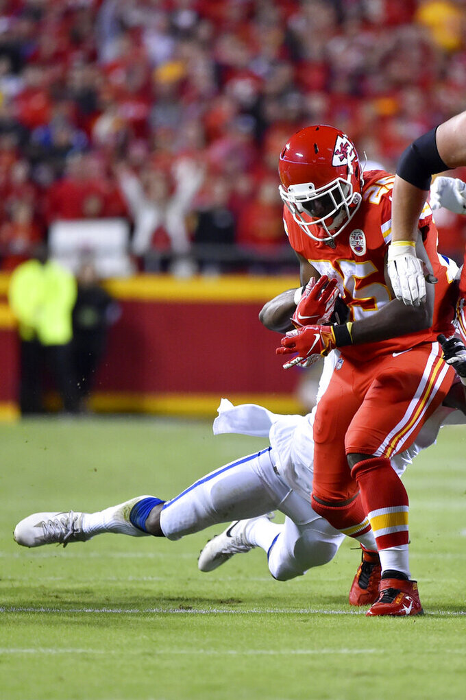 Indianapolis Colts safety George Odum strips the ball from Kansas City Chiefs running back LeSean McCoy (25) for a turnover during the first half of an NFL football game in Kansas City, Mo., Sunday, Oct. 6, 2019. (AP Photo/Ed Zurga)