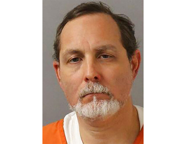 This booking photo provided by Metro Nashville Police Department shows Alexander Friedmann.  Friedmann, the longtime prison reform advocate accused of preparing to stage an escape at a Tennessee jail that's under construction had a builder create a concrete room in his condominium's basement so he could learn how to break into the walls, authorities say, Tuesday, May 26, 2020.      (Metro Nashville Police Department via AP)