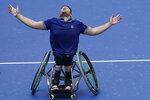 Dylan Alcott, of Australia, reacts after defeating Niels Vink, of the Netherlands, during the men's wheelchair quad singles final at the U.S. Open tennis tournament in New York, Sunday, Sept. 12, 2021. (AP Photo/Seth Wenig)