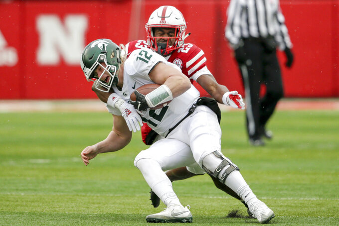Michigan State quarterback Rocky Lombardi (12) is tackled by Nebraska defensive back Dicaprio Bootle (23) during the first half of an NCAA college football game in Lincoln, Neb., Saturday, Nov. 17, 2018. (AP Photo/Nati Harnik)