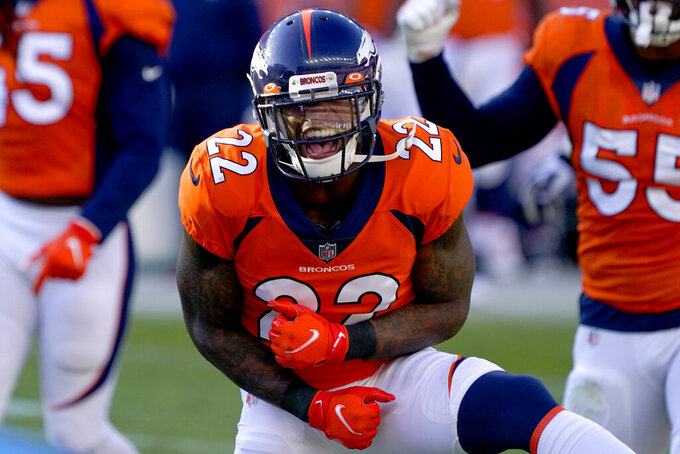 Denver Broncos strong safety Kareem Jackson (22) celebrates a defensives to against the Los Angeles Chargers during the first half of an NFL football game, Sunday, Nov. 1, 2020, in Denver. (AP Photo/David Zalubowski)
