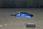 A car is stuck in a flooded tunnel in Beirut's southern suburb of Ouzai, Lebanon, Monday, Dec. 9, 2019. A rainstorm paralyzed parts of Lebanon's capital Beirut on Monday, turning streets to small rivers, stranding motorists inside their vehicles and damaging homes in some areas. (AP Photo/Bilal Hussein)