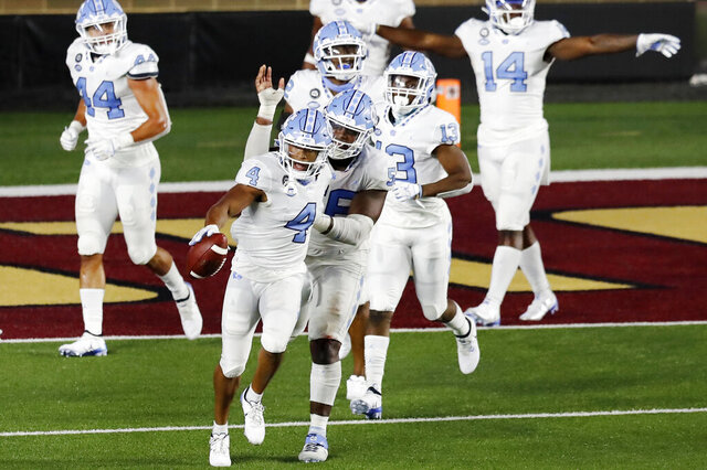 North Carolina defensive back Trey Morrison (4) celebrates after running the ball back on an interception of a two-point conversion attempt by Boston College during the second half of an NCAA college football game, Saturday, Oct. 3, 2020, in Boston. (AP Photo/Michael Dwyer)