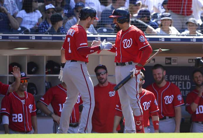 Washington Nationals' Trea Turner, front left, is congratulated at the dugout by Anthony Rendon after hitting a home run during the eighth inning of a baseball game against the San Diego Padres, Sunday, June 9, 2019, in San Diego. (AP Photo/Orlando Ramirez)