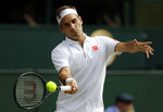 Switzerland's Roger Federer returns the ball to Spain's Rafael Nadal during a men's singles semifinal match on day eleven of the Wimbledon Tennis Championships in London, Friday, July 12, 2019. (AP Photo/Ben Curtis)