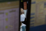 A currency trader wears a face mask at the foreign exchange dealing room of the KEB Hana Bank headquarters in Seoul, South Korea, Tuesday, Feb. 11, 2020. Asian stock markets followed Wall Street higher on Tuesday, at least temporarily shaking off jitters about China's virus outbreak. (AP Photo/Ahn Young-joon)
