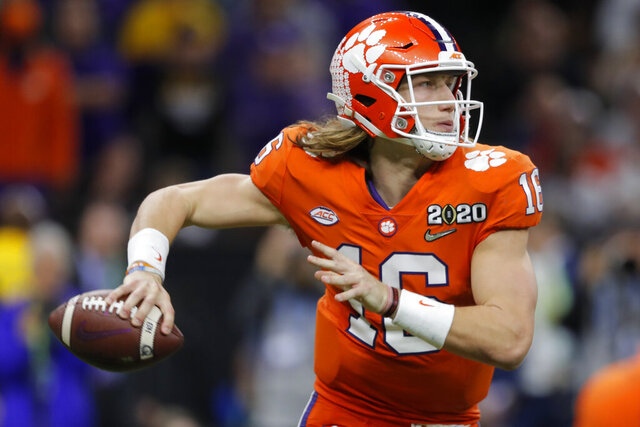 FILE - In this Jan. 13, 2020, file photo, Clemson quarterback Trevor Lawrence passes against LSU during the second half of a NCAA College Football Playoff national championship game, in New Orleans. Lawrence is on a streak of 314 pass attempts without an interception, a run dating back to last Oct. 19 when he was picked off twice at Louisville in Clemson's 45-10 victory. (AP Photo/Gerald Herbert, File)